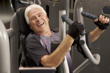 man working out with weight machines