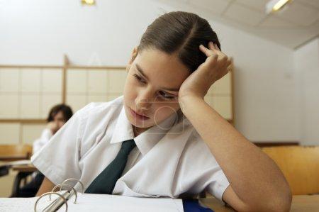 Bored schoolgirl at desk