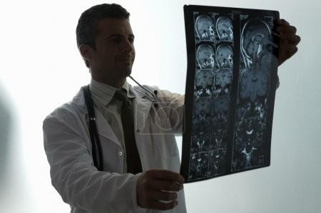 Doctor looking at MRI scan