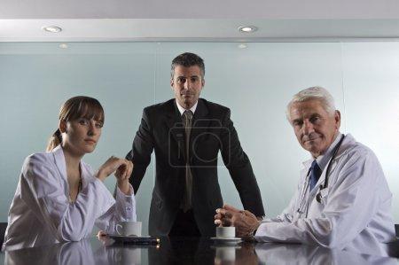 hospital staff at board meeting
