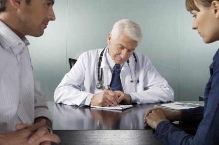 Doctor working with patients in office