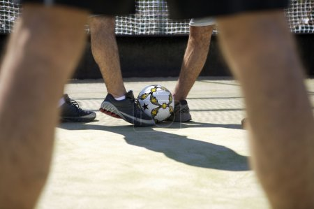 Photo for Cropped image of male legs playing football - Royalty Free Image