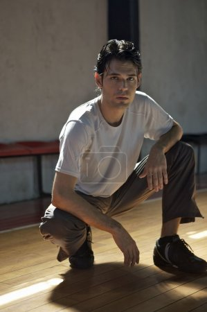 man squat  in sport hall