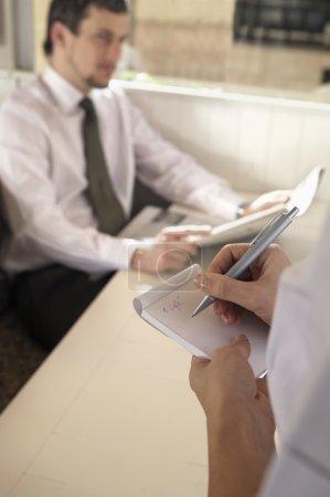 Waitress hands writing order