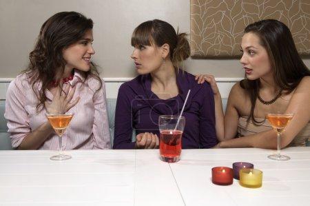 young women talking in restaurant