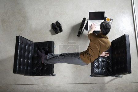 Businessman practicing yoga at office