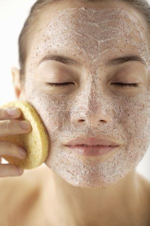 woman having facial mask