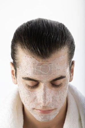 man having a facial mask