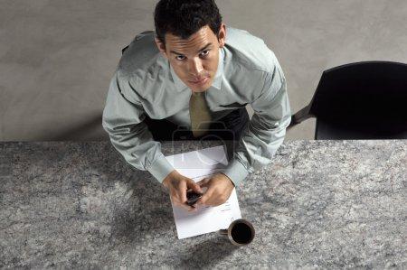 Business man reading paperwork
