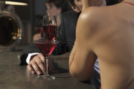 couple  at a bar drinking coctails