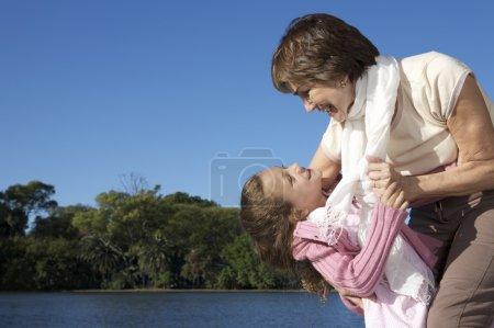 Grandmother holding her granddaughter