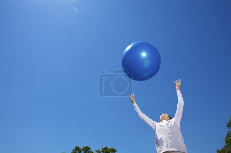 Woman with blue ball