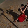 Latin couple dancing Tango in the street,man and a...
