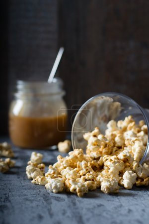 Popcorn with caramel in glass bowl