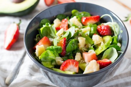 Photo for Salad with strawberries and quinoa in bowl - Royalty Free Image