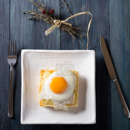 Croque madame on white dish