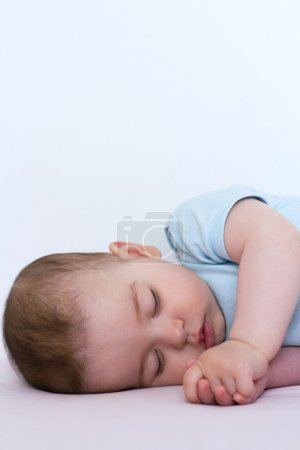 Adorable and beautiful sleeping baby on white background