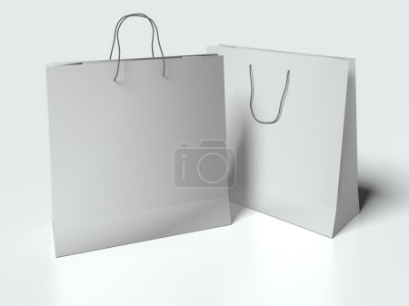 Light gray paper bag with handles on white background. mock up