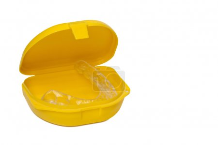 Mouth guard in its container