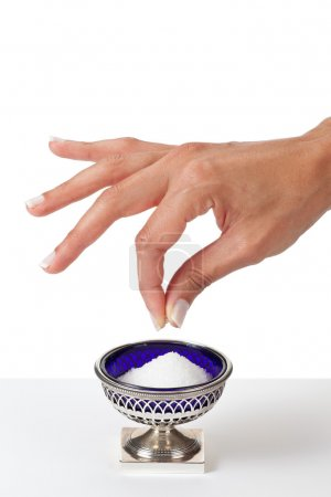 hand grabbing a pinch of salt