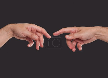 Two hands about to touch