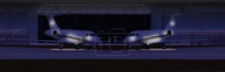 Photo pour Deux avions privés devant un hangar dans la nuit - image libre de droit