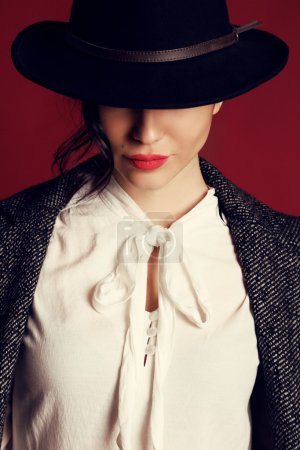 Photo for Fashion studio photo of gorgeous woman with dark hair and evening makeup in elegant clothes and hat - Royalty Free Image