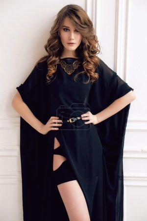 Photo for Fashion studio photo of gorgeous woman with dark hair in elegant dress and bijou - Royalty Free Image