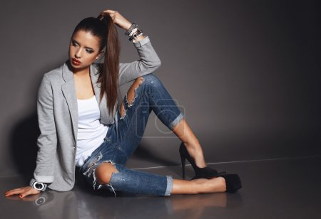 beautiful young woman with dark hair wears casual clothes