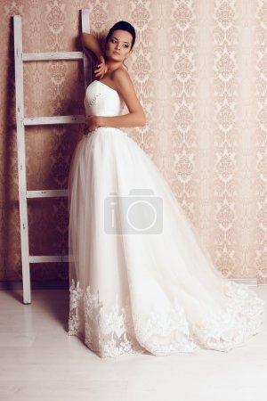 beautiful tender bride in elegant wedding dress