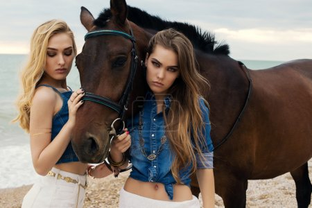 beautiful young women with black horse