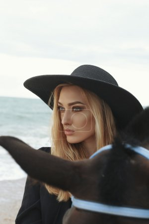 Beautiful woman  with black horse