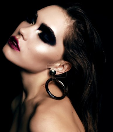 Beautiful woman with black smokey eyes