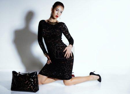 Sensual woman in black lace dress