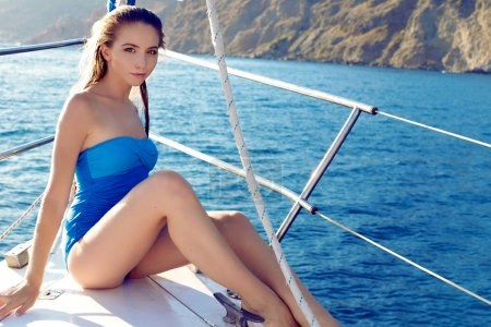 Photo for Beautiful woman in swimsuit relaxing on yacht in the open ocean Fashion outdoor summer photo - Royalty Free Image