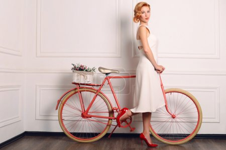 beautiful woman in retro dress with bicycle