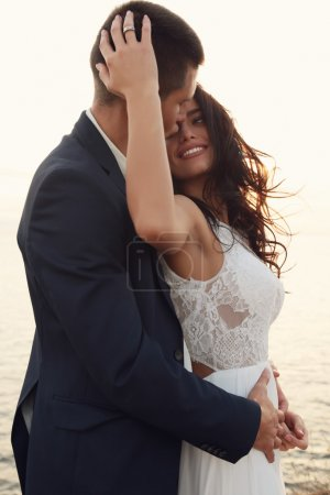 beautiful groom and bride in wedding clothes