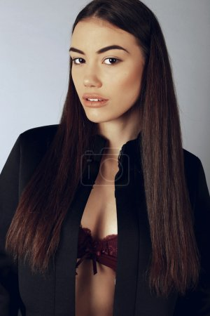 Photo for Fashion studio photo of beautiful girl with dark straight hair wears casual clothes - Royalty Free Image