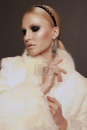 Woman wears luxurious fur coat