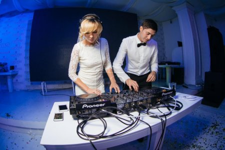 Bride and groom behind the control panel
