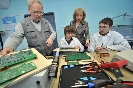 College students in electrical engineering in the classroom