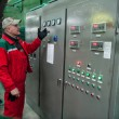 Постер, плакат: Electrical engineer from the dashboard controls the electrical p