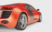 Oranžové sportovní auto na bílém pozadí
