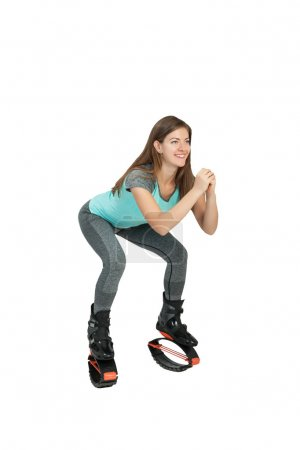 Girl crouches in boots kangoo jumps