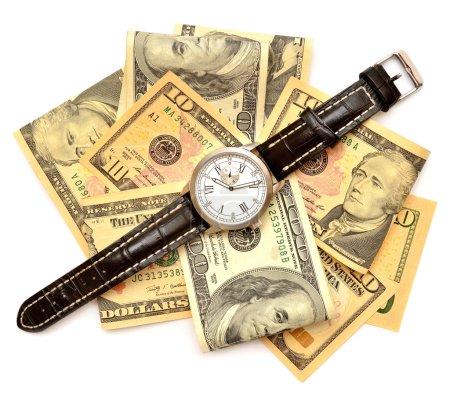 Photo pour Billets de dollars et montre à main - image libre de droit