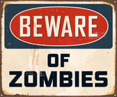 Vintage Metal Sign - Beware of Zombies - Vector EPS10 Grunge effects can be easily removed for a brand new clean design