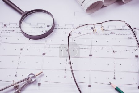 Ruler, eraser, glasses and a pencil on the floor plan - Bussines a still-life