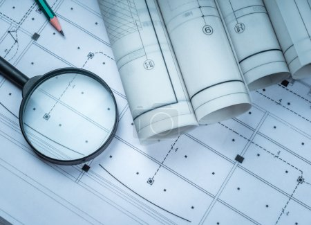 Photo for Architectural blueprints and blueprint rolls and a drawing instruments on the worktable - Royalty Free Image