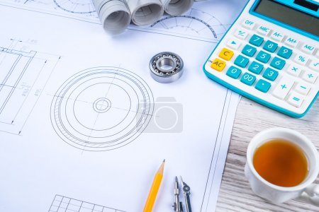 Photo for Pen, tea and calculator on paper table with diagram - Royalty Free Image