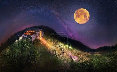 Silhouettes in Carpathians near hut